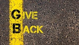 47638294 - concept image of business acronym gb as give back written over road marking yellow paint line.